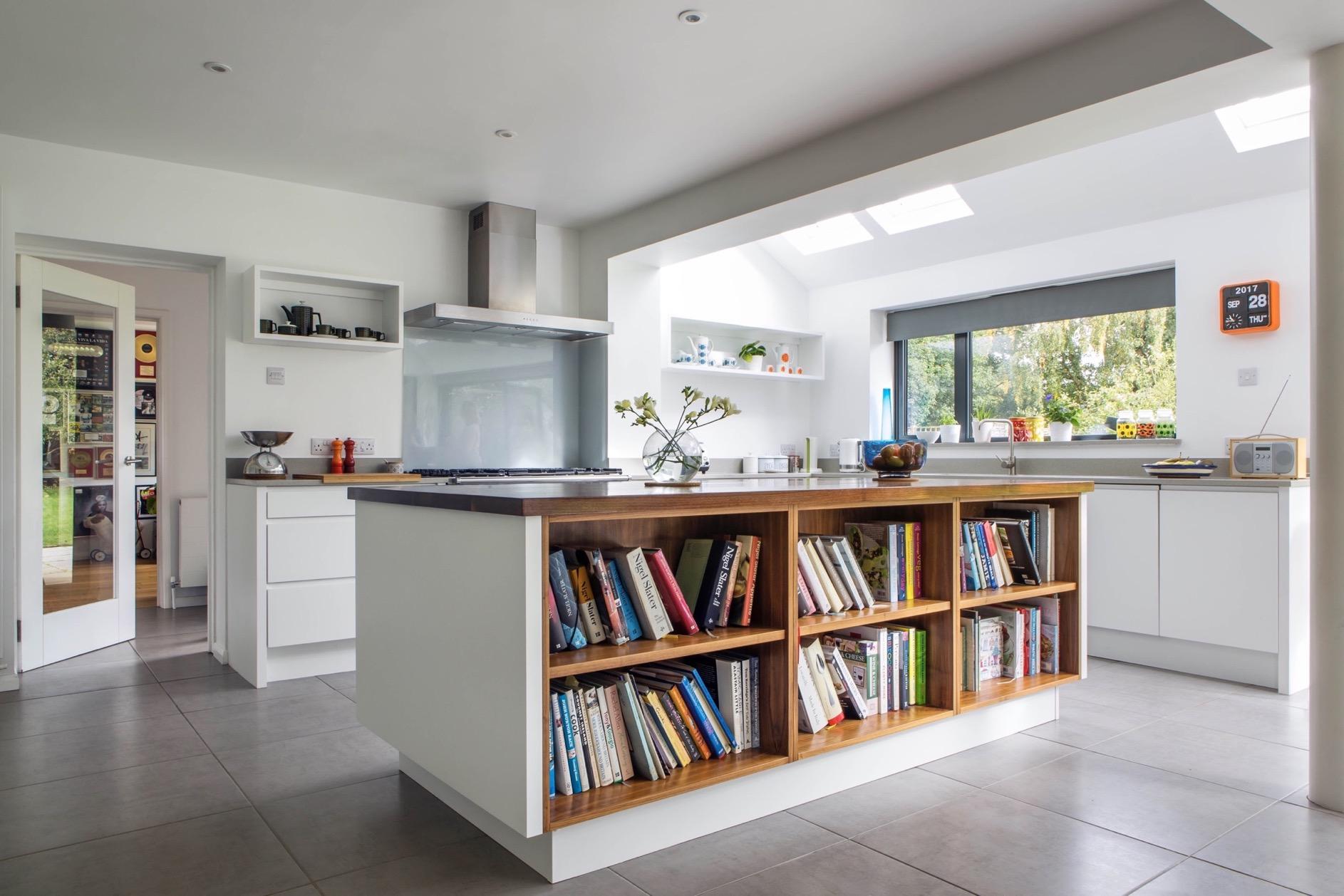 Walnut kitchen island bookshelves glass backsplash handleless aylesbury buckinghamshire 1