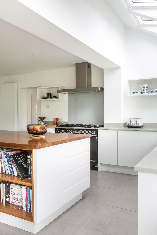 Walnut kitchen island bookshelves glass backsplash handleless aylesbury bucks