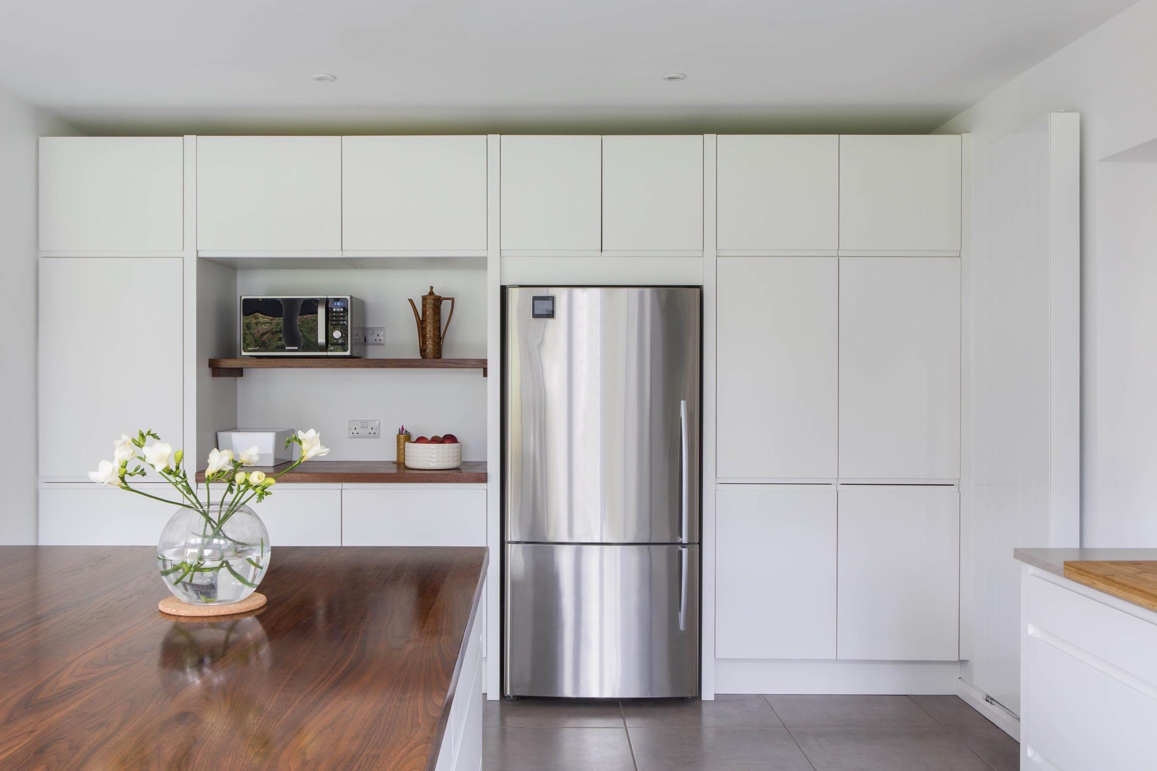 Walnut kitchen island handleless stainless steel fridge aylesbury buckinghamshire 1