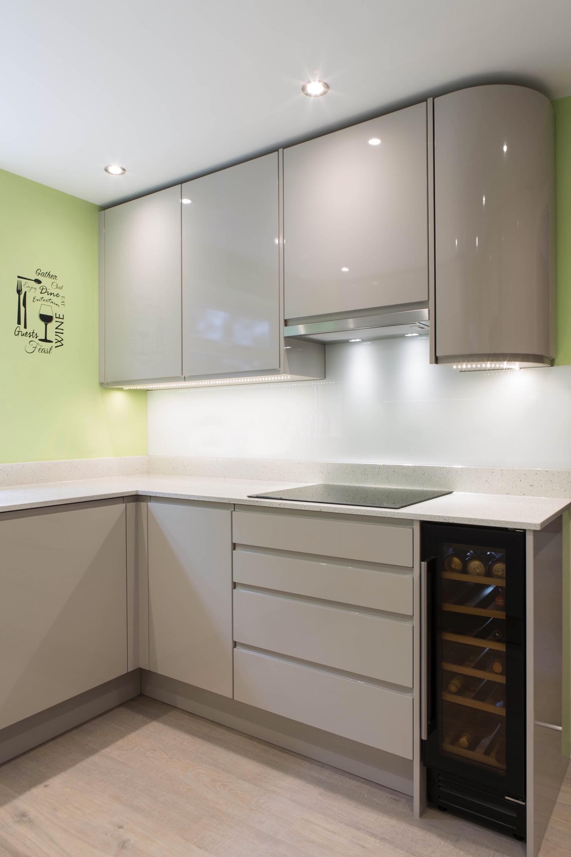 gloss handleless kitchen wine fridge curved cupboard aylesbury buckinghamshire 1
